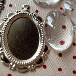 10 Sets of Transparent Oval Glass Domes (13mmx18mm) and matching Silver Photo Frames